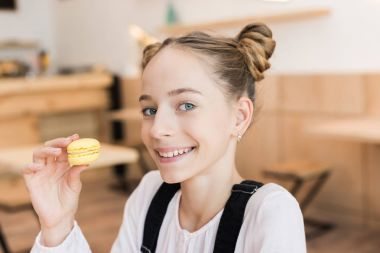 beautiful teen girl with macaroon