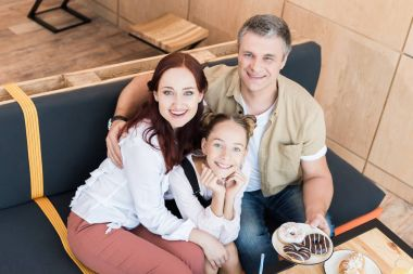 beautiful family in cafe