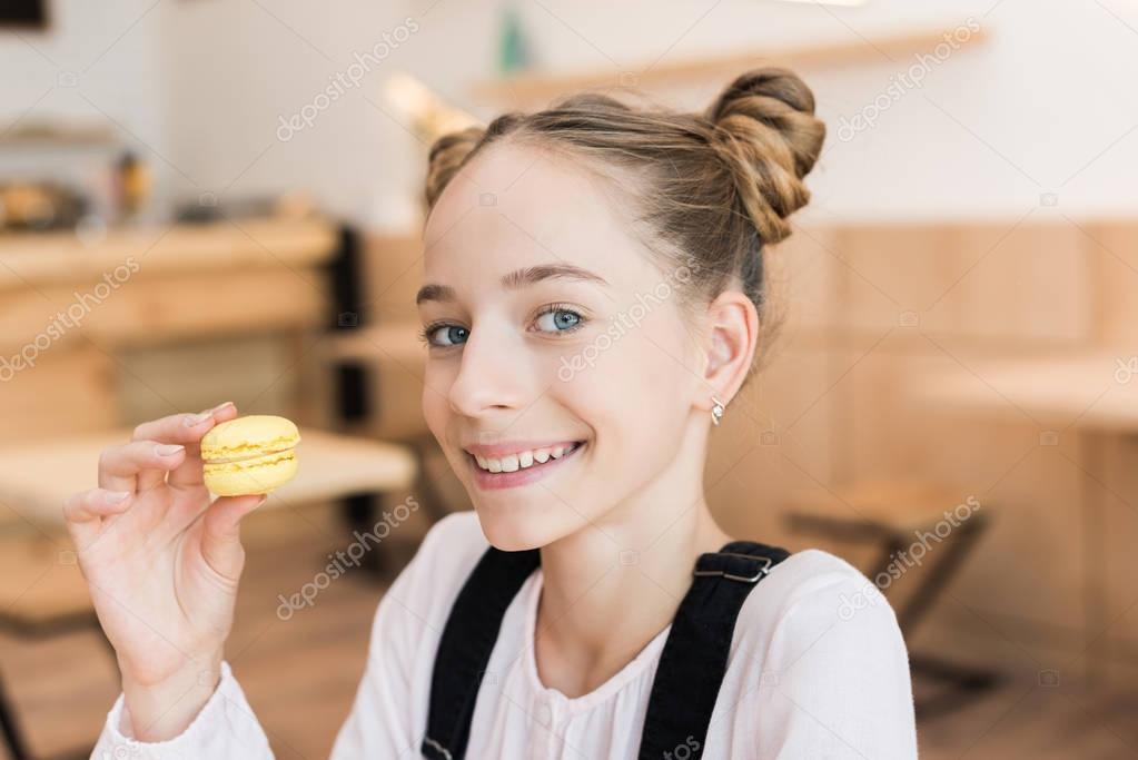 beautiful teen girl with macaroon