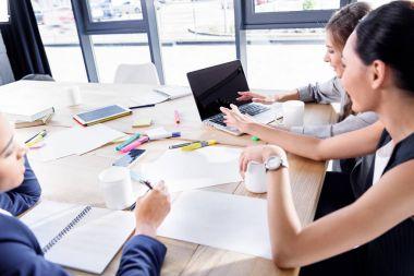 multiethnic businesswomen working together