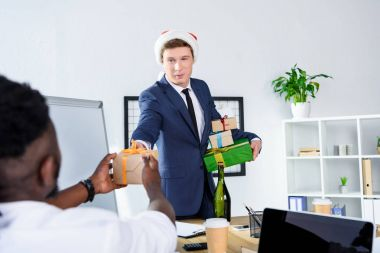 businessman presenting gift to colleague