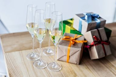 champagne glasses and gift boxes