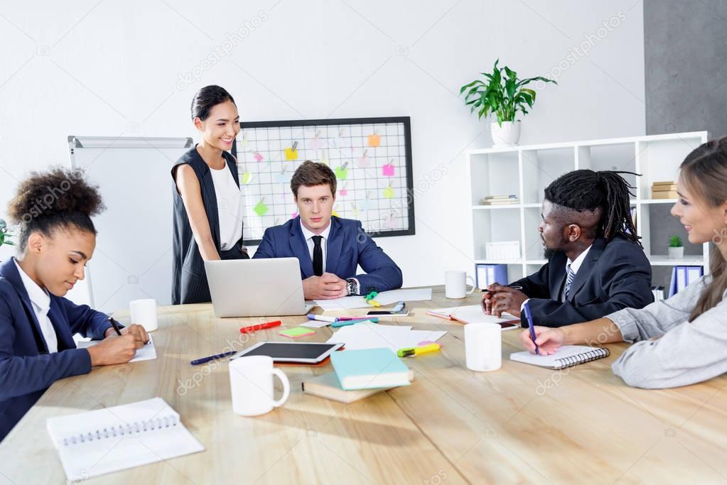multiethnic colleagues having business meeting