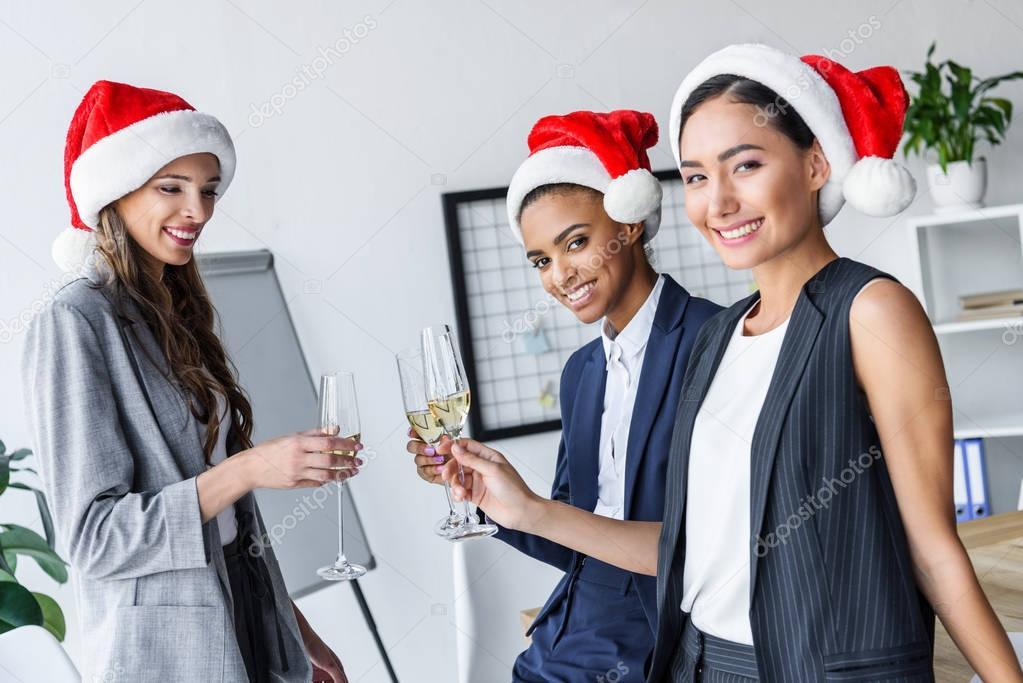 businesswomen drinking champagne in office