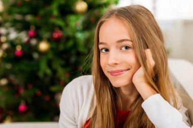 teen girl with christmas tree