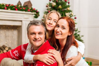 family embracing on christmas