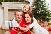 Fotografie family taking selfie on christmas