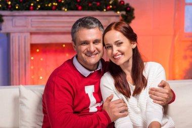 mature couple embracing on christmas