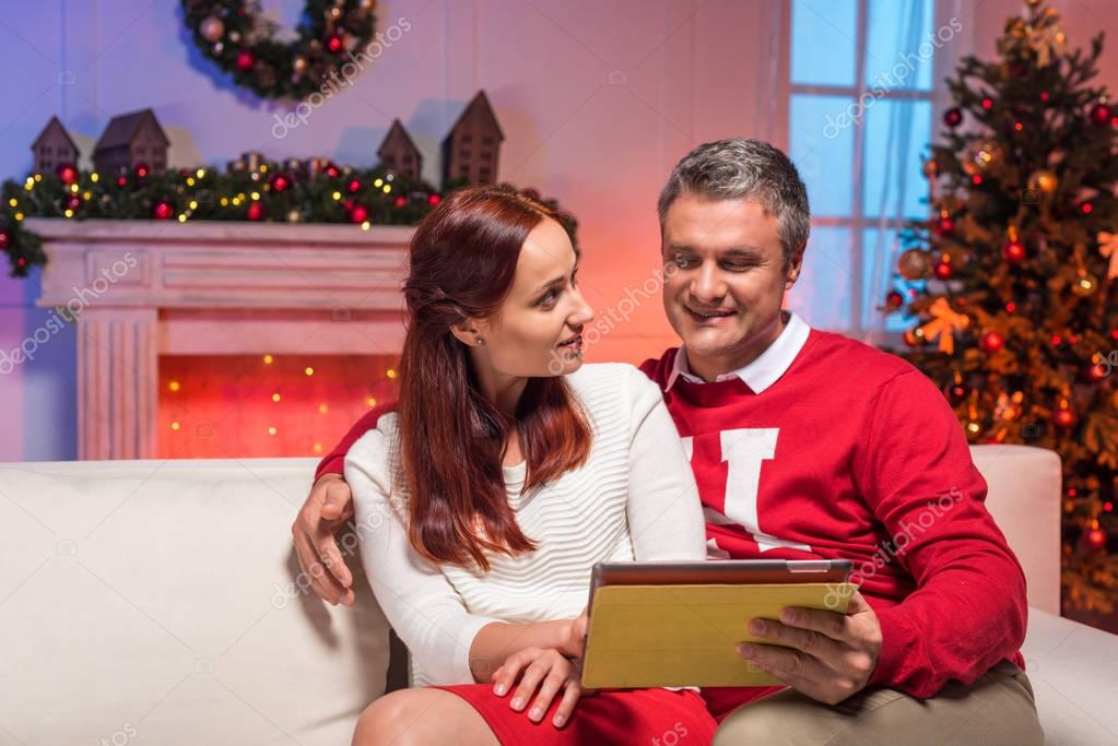 mature couple using tablet
