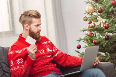 man shopping online at christmas