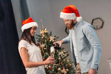 Couple drinking champagne at christmastime