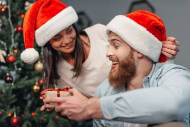 Young couple with christmas present