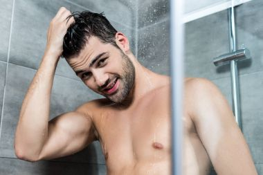 young man taking shower