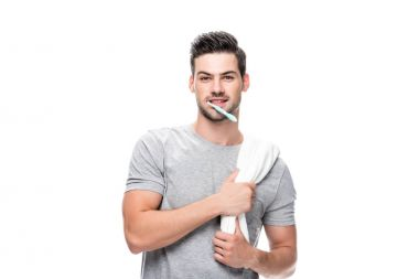 Man with toothbrush and towel
