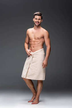 Man covering with towel after shower