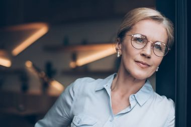 pensive woman in eyeglasses