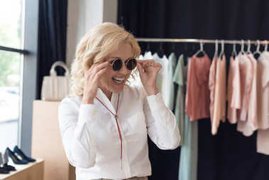 woman shopping in clothing boutique
