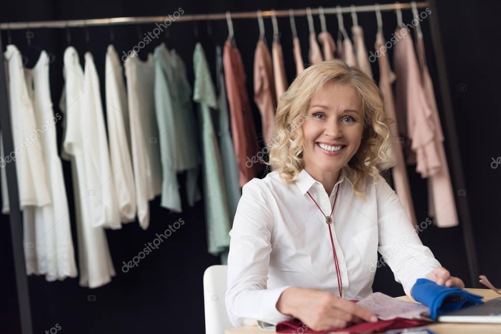 businesswoman choosing fabric samplers