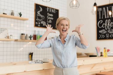 excited businesswoman in cafe