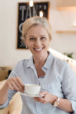 Mature woman drinking coffee