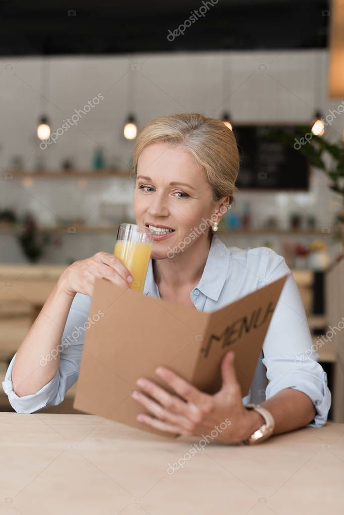 woman reading menu in cafe