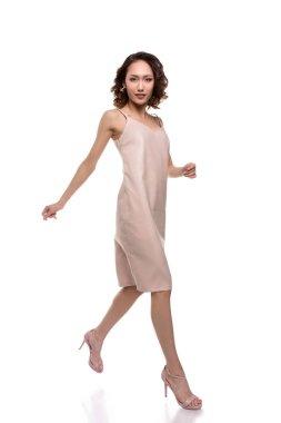 asian girl in dress walking