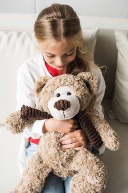 child with teddy bear