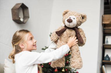 adorable kid with teddy bear