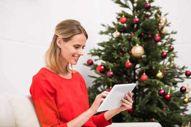 woman using tablet at christmas