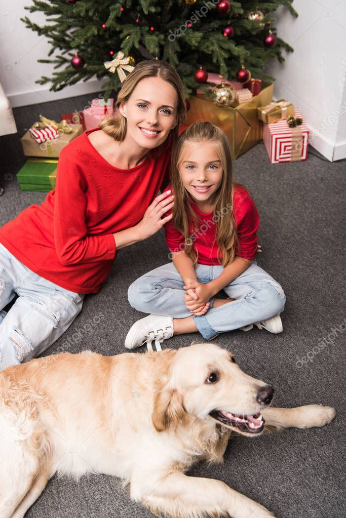 happy mother and daughter with dog