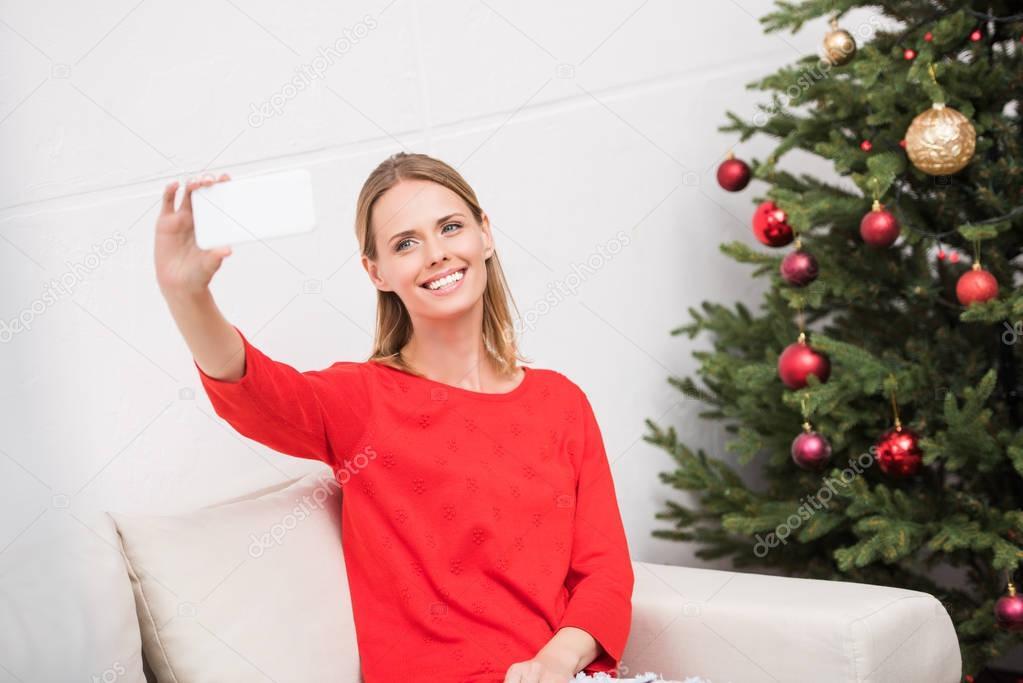 woman taking christmas selfie