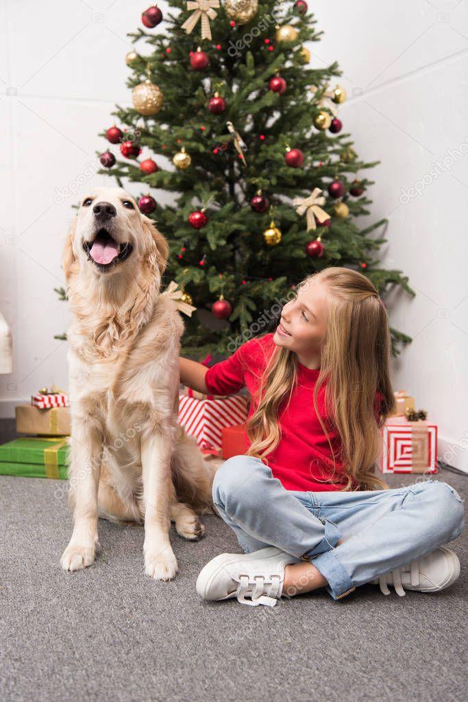 kid with dog at christmas eve