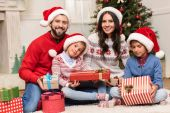 Photo family with christmas presents