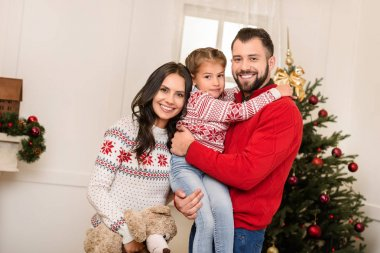 happy family with teddy bear at christmas