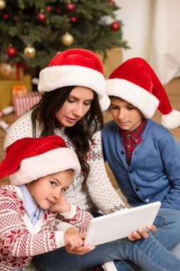 family with digital tablet at christmas
