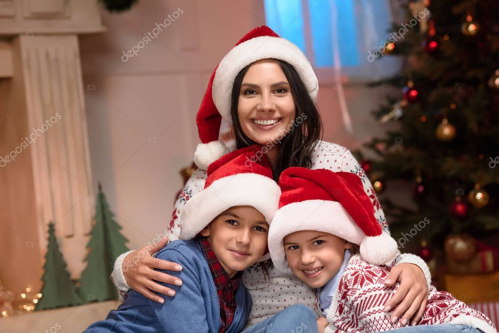 mother with kids in santa hats