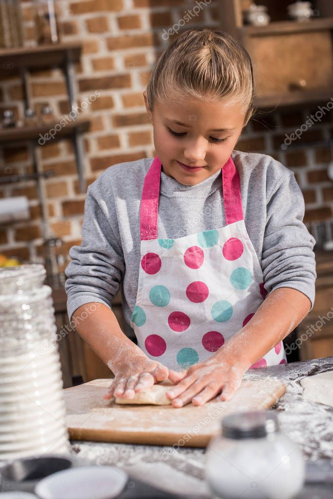 kid rolling dough