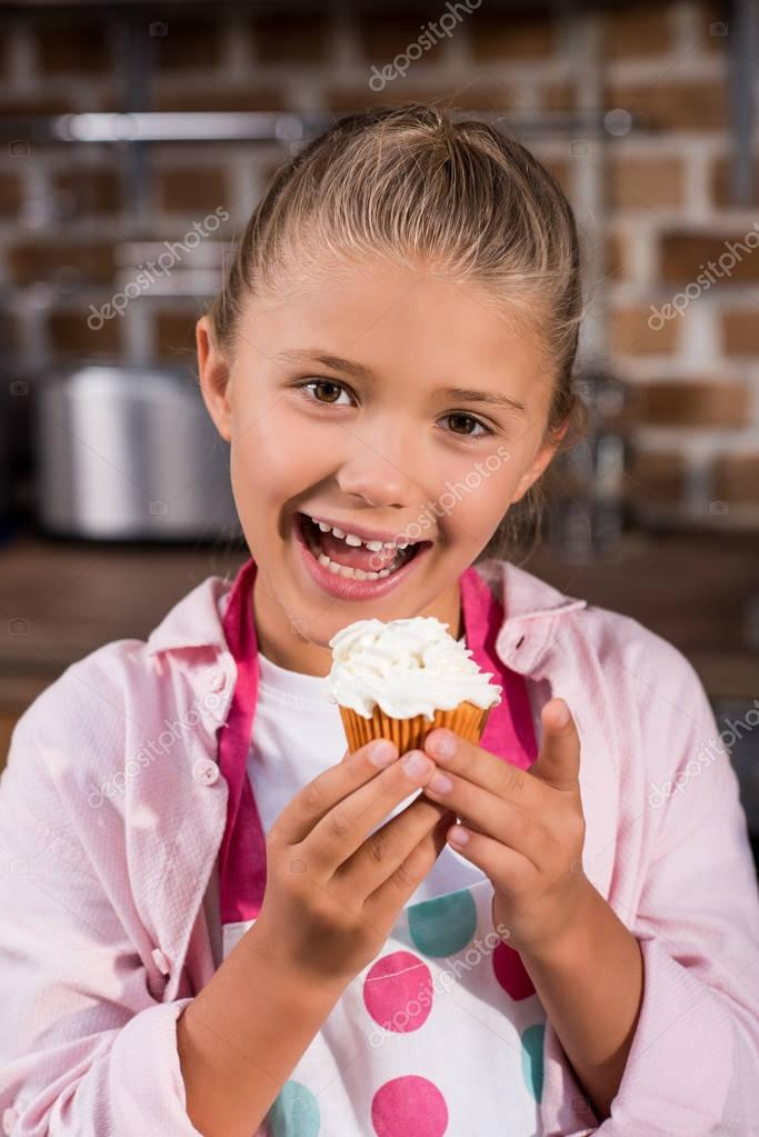 child with sweet cupcake