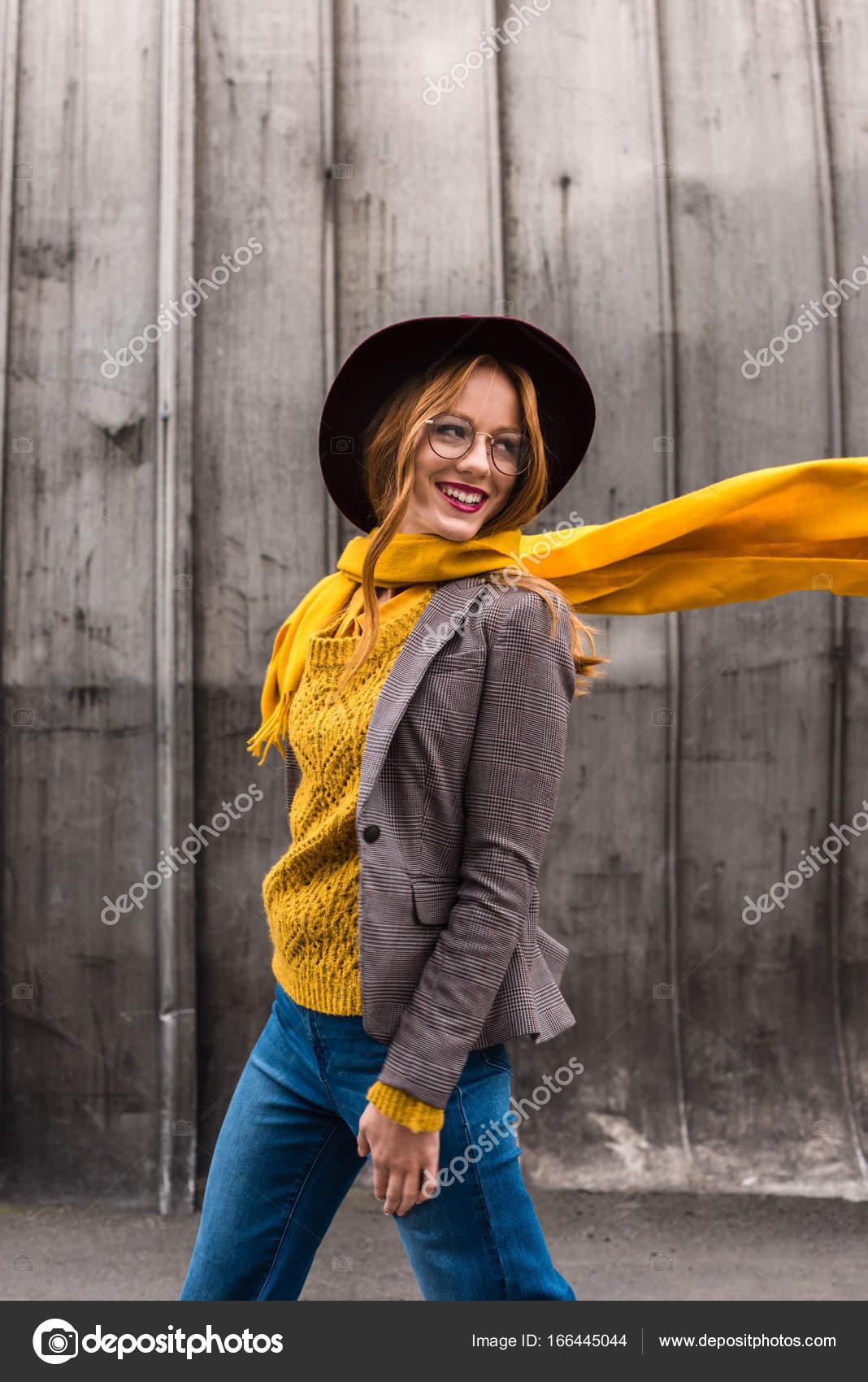 ddff1148c67 Beautiful stylish redhead girl in fedora hat and yellow scarf — Photo by  AllaSerebrina