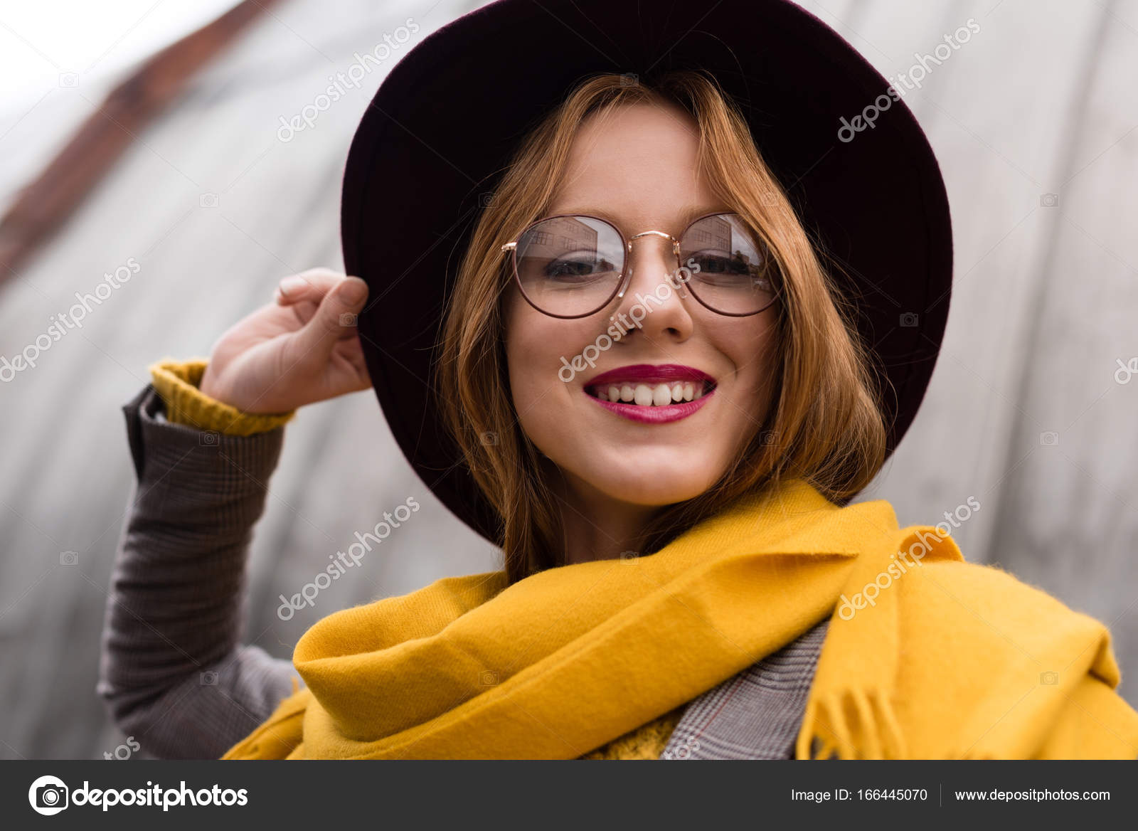a4edbed6972 Beautiful stylish smiling redhead girl in eyeglasses