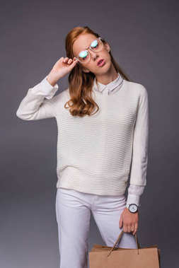 Girl in eyeglasses with shopping bags
