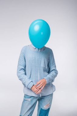 girl in blue with balloon