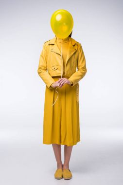 stylish girl in yellow clothes