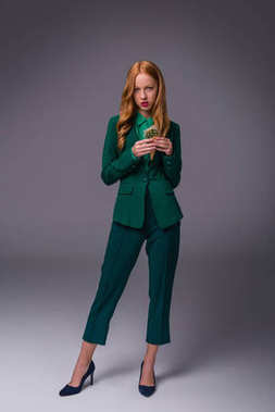 stylish girl in green suit