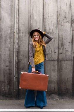 stylish girl with suitcase