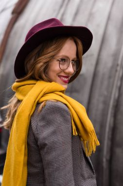 Beautiful stylish redhead girl in fedora hat and yellow scarf stock vector