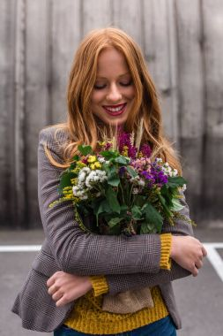 Redhead girl with bouquet