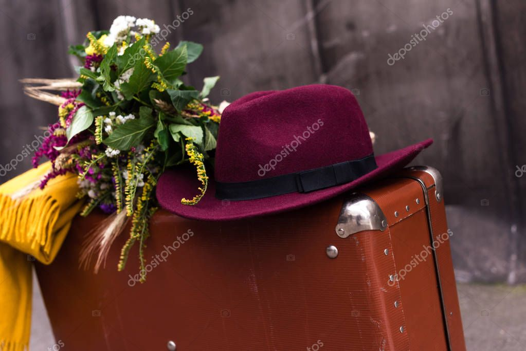 suitcase with flowers and hat