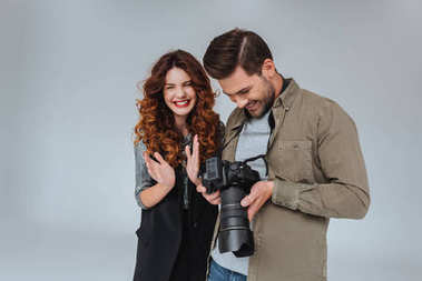 Attractive model and professional photographer with photo camera on fashion shoot in photo studio stock vector