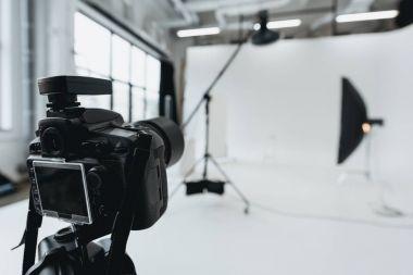 Digital photo camera in photo studio with lighting equipment and softbox stock vector